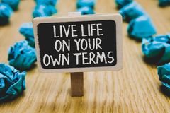 Handwriting text writing Live Life On Your Own Terms. Concept meaning Give yourself guidelines for a good living Stand blackboard. Handwriting text writing ve fe royalty free stock photo