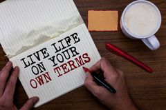 Handwriting text writing Live Life On Your Own Terms. Concept meaning Give yourself guidelines for a good living Sticky note red p. En coffee with coffee mug royalty free stock photos