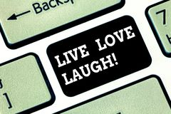 Handwriting text writing Live Love Laugh. Concept meaning Be inspired positive enjoy your days laughing good humor Keyboard key. Intention to create computer stock photo