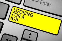Handwriting text writing Looking For A Job. Concept meaning Unemployed seeking work Recruitment Human Resources Ashy computer keyb. Oard with yellow button black royalty free stock photos