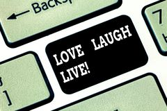 Handwriting text writing Love Laugh Live. Concept meaning Be inspired positive enjoy your days laughing good humor. Keyboard key Intention to create computer royalty free stock image