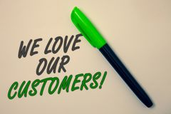 Handwriting text writing We Love Our Customers Call. Concept meaning Client deserves good service satisfaction respect Ideas messa. Ge beige background green pen Stock Photography