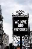 Handwriting text writing We Love Our Customers Call. Concept meaning Client deserves good service satisfaction respect Vintage bla. Ck board white letters words Stock Photo