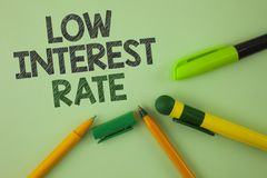 Handwriting text writing Low Interest Rate. Concept meaning Manage money wisely pay lesser rates save higher written on Plain Gree. Handwriting text writing Low royalty free stock photos