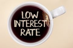 Handwriting text writing Low Interest Rate. Concept meaning Manage money wisely pay lesser rates save higher written on Tea in a C. Handwriting text writing Low royalty free stock photos
