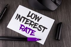 Handwriting text writing Low Interest Rate. Concept meaning Manage money wisely pay lesser rates save higher written on White Stic. Handwriting text writing Low royalty free stock photos