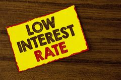 Handwriting text writing Low Interest Rate. Concept meaning Manage money wisely pay lesser rates save higher written on Yellow Sti. Handwriting text writing Low royalty free stock photos