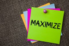 Handwriting text writing Maximize. Concept meaning Increase to the greatest possible amount or degree Make larger Sticky cards boa. Rd pinned muliple colours royalty free stock photos