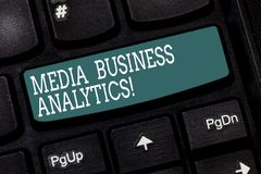 Handwriting text writing Media Business Analytics. Concept meaning Collecting and evaluating data from social media. Keyboard key Intention to create computer stock photos