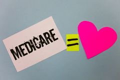 Handwriting text writing Medicare. Concept meaning Federal health insurance for people above 65 or with disabilities Equal symbol. Sticky notes heart love plane stock images