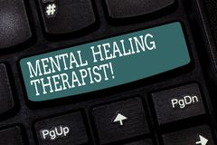 Handwriting text writing Mental Healing Therapist. Concept meaning Counseling or treating clients with mental disorder Keyboard. Key Intention to create royalty free illustration