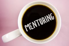 Handwriting text writing Mentoring. Concept meaning To give advice or support to a younger less experienced person written on Blac. Handwriting text writing Royalty Free Stock Photography