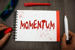 Handwriting text writing Momentum. Concept meaning Quantity motion in moving body Product of mass and velocity Googles glasses pen. Marker cap notepad notebook stock photo