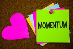 Handwriting text writing Momentum. Concept meaning Quantity motion in moving body Product of mass and velocity Thumb pinned sticky. Cards love heart messages stock photos