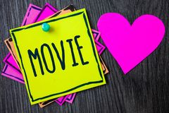 Handwriting text writing Movie. Concept meaning Cinema or television film Motion picture Video displayed on screen Border sticky r. Emember cards love heart Stock Photography