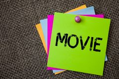 Handwriting text writing Movie. Concept meaning Cinema or television film Motion picture Video displayed on screen Sticky cards bo. Ard pinned muliple colours Stock Photos