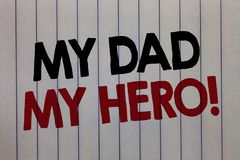 Handwriting text writing My Dad My Hero. Concept meaning Admiration for your father love feelings emotions compliment. White vertical paper written three words stock photo