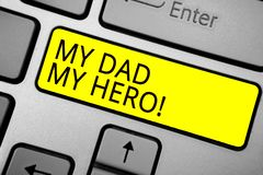 Handwriting text writing My Dad My Hero. Concept meaning Admiration for your father love feelings emotions compliment Ashy compute. R keyboard with yellow button royalty free stock image