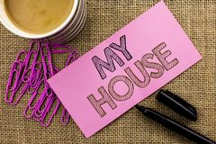 Handwriting text writing My House. Concept meaning Housing Home Residential Property Family Household New Estate written on Pink S Royalty Free Stock Photo