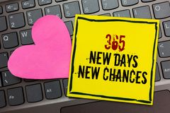 Handwriting text writing 365 New Days New Chances. Concept meaning Starting another year Calendar Opportunities Written on black b. Ordered yellow page touched stock image