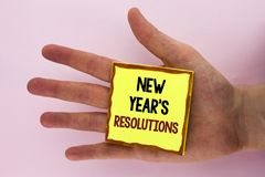 Handwriting text writing New Year'S Resolutions. Concept meaning Goals Objectives Targets Decisions for next 365 days written on. Handwriting text writing New Stock Image