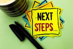 Handwriting text writing Next Steps.... Concept meaning Following Moves Strategy Plan Give Directions Guideline written on Sticky. Handwriting text writing Next Royalty Free Stock Photo