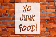 Handwriting text writing No Junk Food. Concept meaning Stop eating unhealthy things go on a diet give up burgers fries Brick Wall. Art like Graffiti stock photography