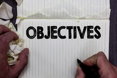 Handwriting text writing Objectives. Concept meaning Goals planned to be achieved Desired targets Company missions Notebook regist. Er handwork line drawing royalty free stock image