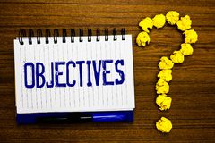 Handwriting text writing Objectives. Concept meaning Goals planned to be achieved Desired targets Company missions Study notebook. Register ink pen question stock images