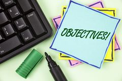 Handwriting text writing Objectives Motivational Call. Concept meaning Goals planned to be achieved Desired targets written on Sti. Handwriting text writing stock photo