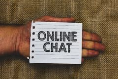 Handwriting text writing Online Chat. Concept meaning talking with friend or someone through internet and PC phone Man hand holdin. G piece notebook paper jute royalty free stock photography
