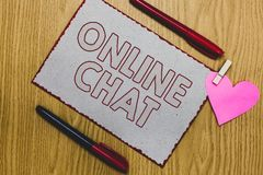 Handwriting text writing Online Chat. Concept meaning talking with friend or someone through internet and PC phone Piece paper clo. Thespin holding heart markers royalty free stock photography