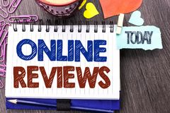 Handwriting text writing Online Reviews. Concept meaning Internet Evaluations Customer Rating Opinions Satisfaction written on Not. Handwriting text writing Stock Photo