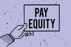 Handwriting text writing Pay Equity. Concept meaning eliminating sex and race discrimination in wage systems Man hand holding pape. R communicating information royalty free illustration