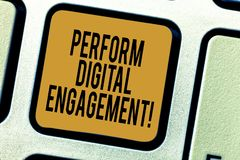 Handwriting text writing Perform Digital Engagement. Concept meaning use of social media by a corporate organisation. Keyboard key Intention to create computer stock images