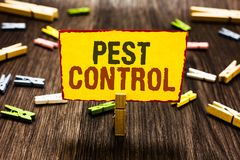 Handwriting text writing Pest Control. Concept meaning Killing destructive insects that attacks crops and livestock Clothespin hol