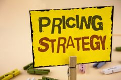 Handwriting text writing Pricing Strategy. Concept meaning Marketing sales strategies profit promotion campaign written on Yellow. Handwriting text writing Stock Images