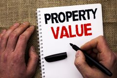Handwriting text writing Property Value. Concept meaning Estimate of Worth Real Estate Residential Valuation written by Man Holdin. G Marker Notebook Book the royalty free stock image
