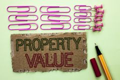 Handwriting text writing Property Value. Concept meaning Estimate of Worth Real Estate Residential Valuation written on Tear Cardb. Handwriting text writing royalty free stock image