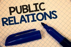 Handwriting text writing Public Relations. Concept meaning Communication Media People Information Publicity Social Text two Words. Written paper open blue royalty free stock image