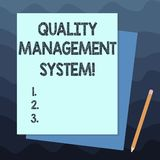Handwriting text writing Quality Management System. Concept meaning formalized system that documents processes Stack of Blank. Different Pastel Color stock photography
