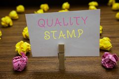 Handwriting text writing Quality Stamp. Concept meaning Seal of Approval Good Impression Qualified Passed Inspection Clothespin ho. Lding white paper note stock photo
