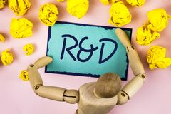 Handwriting text writing R D. Concept meaning Research and Development Scientific Investigations Innovations written on Sticky not. Handwriting text writing R D Royalty Free Stock Images