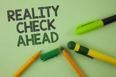 Handwriting text writing Reality Check Ahead. Concept meaning Unveil truth knowing actuality avoid being sceptical written on Plai. Handwriting text writing stock photo