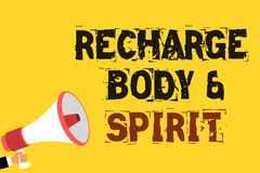 Handwriting text writing Recharge BodyandSpirit. Concept meaning fill your energy through relaxation and having fun Multiline text. Notice board recall reassure Stock Photo