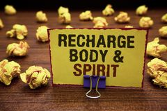 Handwriting text writing Recharge BodyandSpirit. Concept meaning fill your energy through relaxation and having fun Yellow sticky. Card clipped text notice Royalty Free Stock Photography