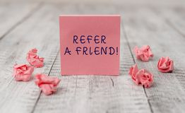 Handwriting text writing Refer A Friend. Concept meaning direct someone to another or send him something like gift Thick. Handwriting text writing Refer A Friend stock photo