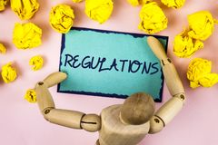 Handwriting text writing Regulations. Concept meaning Rules Laws Corporate Standards Policies Security Statements written on Stick. Handwriting text writing Royalty Free Stock Image