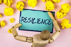 Handwriting text writing Resilience. Concept meaning Capacity to recover quickly from difficulties Persistence written on Sticky n. Handwriting text writing stock images