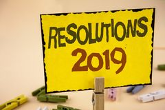 Handwriting text writing Resolutions 2019. Concept meaning Positive reinforcement personal improvent corporate goals written on Ye. Handwriting text writing Royalty Free Stock Photo